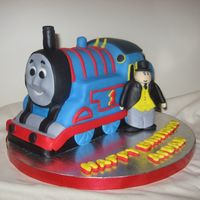 Thomas The Train All fondant. I just started to try carved cakes. I really enjoy making them. I think this was a success. Idea from Debbie Browns book.
