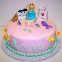 Fondant Figure This was for a mom of 2 who loves to go shopping at target! Everything is edible. Thank you AINE2