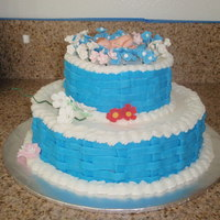 Basketweave Baby Shower Cake Buttercream with sugarpaste flowers.