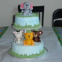 Jungle Theme Birthday Cake This idea was taken from Wilton. I did it fir my younger son's first bday.