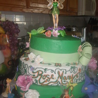 Tinkerbell Cake This was made for a little girl's birthday. The fairies and Tinkerbell was bought by the family. The flowers are all gumpaste.