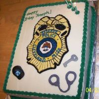 Police Badge Cake B-day cake for a man who is in the police reserves. It's a Strawberry Sour Cream cake, brushed with strawberry simple syrup, frosted...