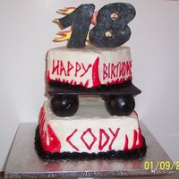 "Cody's 18Th Birthday  Top tier is yellow Bottom tier is chocolate ~ covered in buttecream with fondant accents ~ The ""18"" was carved gumpaste &..."