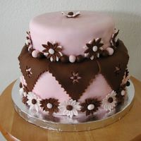 Pink And Brown Daisies  I made this cake for my daughter's 1 year b'day. I love the combination of pink and brown so this is how I came up with the...