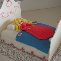 Sleeping Beauty Cake  I made this Sleeping Beauty cake for my daughter's 3rd birthday party last week. The headboard and footboard are made from gumpaste...