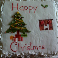 Christmas Cake Fruit cake with royal icing. Most of the art is painted on food colouring
