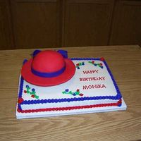 Red Hat   Hat was 1/2 ball covered w/fondant. The rest of the cake was marble with buttercream frosting.