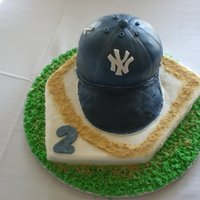 Baseball Cap Grooms Cake Thank You for everyone's help on this one.. chocolate cake for cap, base was buttered cake and cakes were covered in fondant. The brim...