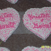 Heart Cookies Cookies made for a wedding shower. Iced in Pink with White lace, and pink bride and grooms name.