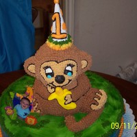 "Monkey Cake Clayton's first birthday cake a monkey (white cake with sprinkles inside) and he is sitting on a 16"" round strawberry french..."