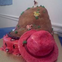 Cowgirl Cake I made this cake for my daughter's 5th party. She wasnted to be a cowgirl.. It's a scarf, mountain and cowgirl hat... Choc and...