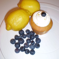 Lemon-Blueberry Lemon cupcake with fresh blueberry topped with lemon curd filling and a blueberry