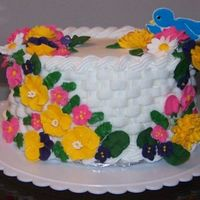 Flower Basket basket weave cake with royal icing flowers.