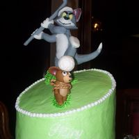 Tom And Jerry Golf A cake i did for my uncle's birthday. He is a big golf fan and my son is a big Tom and Jerry fan so i tried to combine the two.