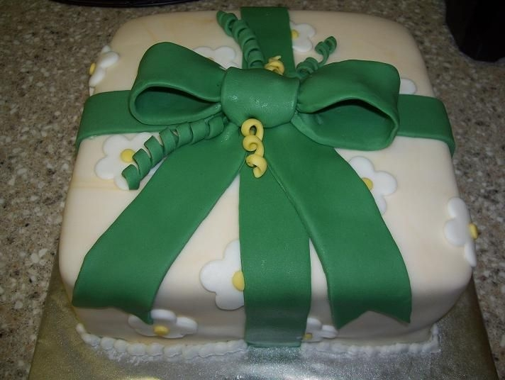 Present   First time covering a cake with fondant, did this for my Wilton course 3 class.