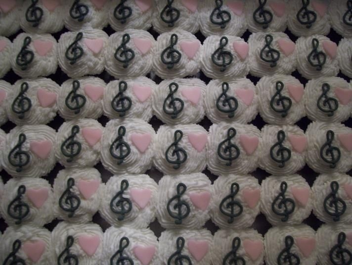 Music Cupcakes Buttercream icing, colorflow treble clefts, and fondant hearts.