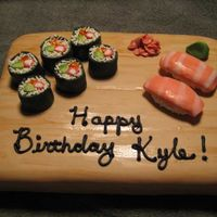 Sushi Cake 9 x 13 sheet cake covered in fondant with handpainted woodgrain. Modelled fondant Sushi pieces.