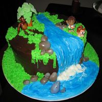 "Go Diego Go 10"" round covered in chocolate icing/ buttercream waterfall and grass. Animals fondant and Diego is plastic."
