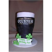 "Guinness Pint 12"" fondant covered cake I made for my husband's birthday (on St. Patty's Day!). I free-handed all the writing using royal..."