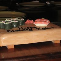 Sushi Cake Side View Side view of the Sushi Cake showing the balsa wood feet making it look like an authentic sushi tray