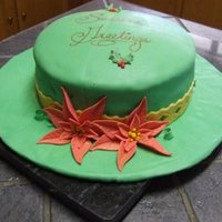Christmas Hat Cake I was learning to do fondant and cover whole cakes (and the cake board, in this case) in fondant. Everything is fondant.