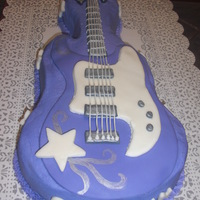 Hannah Montana Guitar Cake This was for my daughter's bday. Cake is covered in purple Buttercream icing and then decorated with MMF.