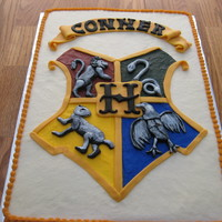 "Hogwarts Crest Cake I made this cake after being inspired by other ""crest"" cakes on the internet. It was for a friend's (who is a Harry Potter..."