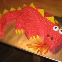 Fiery Dragon Cake not an original design, but I had a lot of fun making this cake - it had wings (made from fruit rollups) but they didn't make it into...