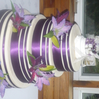 Purple Lilies And Ribbon stryofoam dummy made for a bride , covered in mmfpurple ribbons and silk lilies
