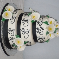 Black Scrolls And Calla Lilies marble cake with almond buttercream covered in mmf50/50 for the call lilies thanks for looking