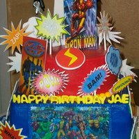 Marvel Superhero Cake Chocolate cakes with strawberry filling and butter cream frosting. There is an edible image on front and back of bottom layer. All...