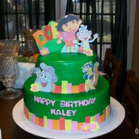 "Dora Cake And Smash Cake 12"" and 8"" all chocolate cake. Made the cake to match the invitation. Butter cream frosting with fondant accents. Characters are..."