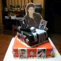 "King Of Pop! 12"" chocolate on bottom 8"" strawberry on top, both filled and covered with butter cream. All pictures are edible images...."