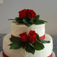 Red Rose Chocolate cake with whipped chocolate ganache filling. Butter cream icing and real roses.