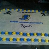 College Graduation Chocolate full sheet cake with buttercream frosting. They graduate was into rugby and wanted to incorporate that into the cake. Picture is...