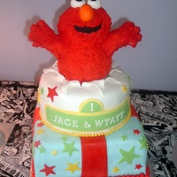 Elmo Birthday Inspired by several amazing elmo themed cakes on this site. Done for 2 boys (cousins) celebrating a 1st birthday together. Elmo is made of...
