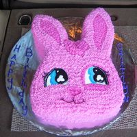 Littlest Pet Shop Bunny Hand carved bunny based off the littlest pet shop characters for a 6 year-old's birthday. Cake is covered in butter cream icing stars...