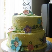Flower Power Cake Buttercream Icing with Fondant Flowers and a hand-crafted wire 8 topper.