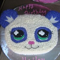 Littlest Pet Shop Panda Hand Carved cake based off the littlest pet shop character. Covered in butter cream icing stars with color flow eyes.