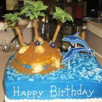Dolphin Island Birthday Cake Butter cream icing with color flow dolphins and gum paste/fondant palm treesq