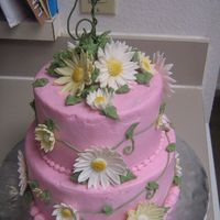 Garden Of Daisies Gum Paste daisies on buttercream icing.