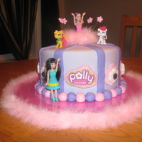 Polly Pocket Cake Vanilla/Vanilla cake covered in fondant w/ polly's on top etc. Inspired by MommaLlama's polly pocket cake :o) thanks for looking...