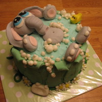 Baby Elephant In Bath cake I made for a baby shower. Fondant decorations (including elephant) french vanilla cake. thanks for looking!!!!