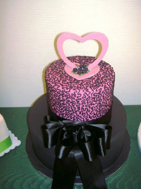 Black And Pink Cake   The black cake is covered with sugarpaste, the pink also with sugarpaste and corneli lace