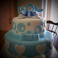 "Baby Shower Cake Fondant covered cake, fondant baby sneakers. I saw this cake on this website made by ""tcthedragonslayer"". Its my very first..."