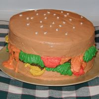 "Burger Cake My first burger cake, I made this for our friend who loves burgers. The ""burger"" is red velvet cake (looked like meat when we cut..."
