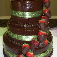 Chocolate Ganache With Strawberries chocolate ganache covered cake with chocolate dipped strawberry cascade