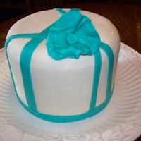 White Cake With Teal Accents. Simple design yet beautiful in it's simplicity