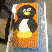 1025081851.jpg   1/2 Chocolate 1/2 Vanilla Bday made for a friend of a friends husband.. Free handed the penguin onto the cake!