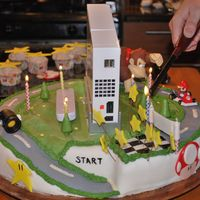 Mario Cart Wii Cake This cake was made for a friends birthday (He got a wii for his birthday..) So we actually put his Wii on the cake as a surprise. The...